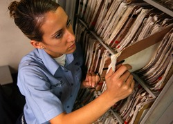 Normal_us_navy_041019-n-5821p-019_airman_lauren_thurgood_of_las_vegas__nev.__pulls_patient_medical_records_in_the_inpatient_ward_aboard_the_conventionally_powered_aircraft_carrier_uss_kitty_hawk